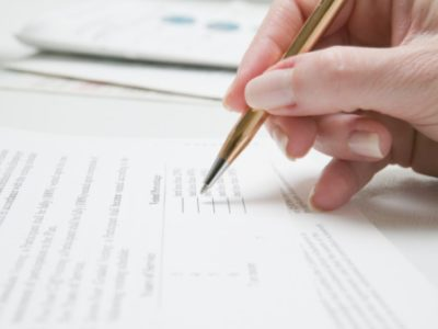 Woman filling out form, close-up